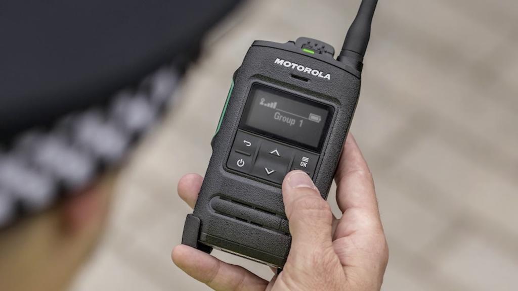 policeman holding Motorola Tetra two-way radio